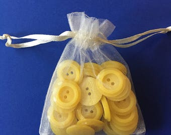 Yellow plastic buttons 1950s  lot of  27 pieces all the same hard plastic  about 1 inch estate find unused