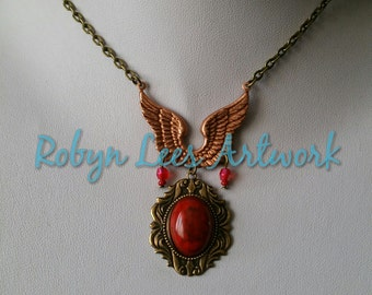 Red Glass Stone Necklace in Bronze Frame with Rose Gold Wings and Red Beads on Bronze Chain. Costume, Different, Cabochon