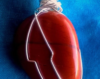 Wire-wrapped red jasper pendant.