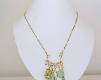 Pendant brass cage, leaf, blue stones (shipping included)