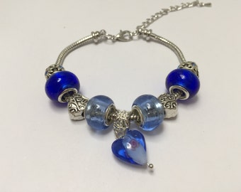 Charm's, blue band, with ref 834 lampwork heart charm