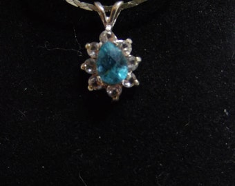 Paraiba Tourmaline necklacce. 8 x 5 mm Pear shape weighing 1.05 ct with 8-2mm Zircon side stones all.925 Sterling Silver. 18' .925 chain.