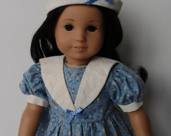 Blue floral dress with sailor style collar and sailor hat. Will fit 18 inch doll such as American Girl, My Life As and My Generation dolls.