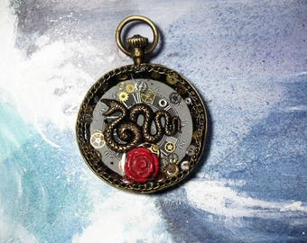 Handmade unisex Steampunk-gothic  pendant made of  brass pocketwatchcase, a snake, a grey dial+gears in resin on a black leather cord