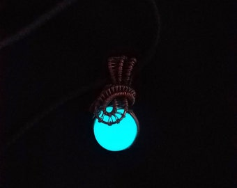 Blue glow in the dark resin sphere wrapped with hand oxidized copper wire pendant necklace