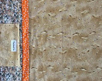 Pillowcase with pocket in Footprints in sand with beach pebbles and orange accent.