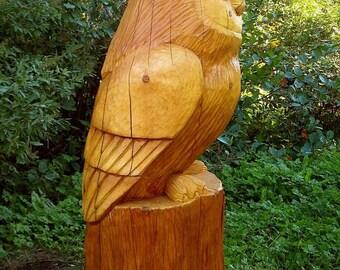 Garden sculpture Owl from a solid cedar log