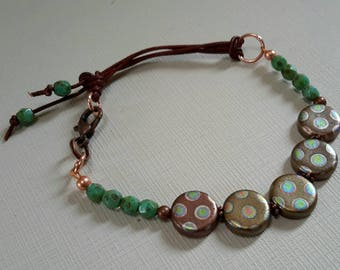 Coin glass in minty chocolate,  leather accents,  fire polished mint green bracelet.