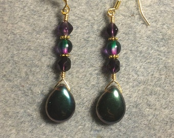 Dark purple and green Czech glass pear drop earrings adorned with purple and green Czech glass beads.