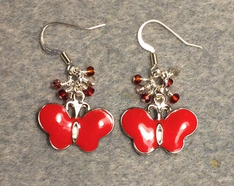 Bright red enamel butterfly charm dangle earrings adorned with tiny clear and red Chinese crystal beads.