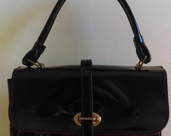 Vintage Black Handbag with Red Accents..