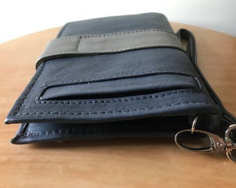 Beautiful luxurious leather phone wallet.Wristlet with 27 card slots, photo windows and pockets. Lots of room. Mini clutch purse