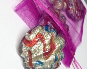 Shells: Shell Murano glass pendants.