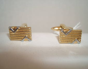 Vintage gold tone cufflinks with silver tone highlights