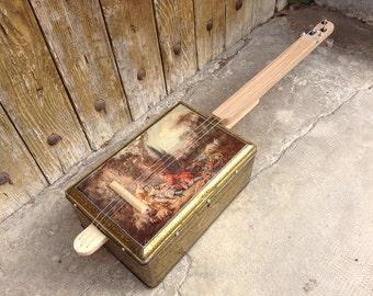 Cigar Box guitar: Box old metal / rebirths landscape / 3 strings