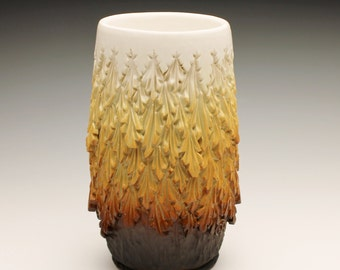 Straw colored carved vase