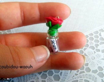Vial scroll miniature and red rose
