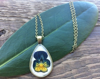 Pressed Pansy Pendant. Organic Jewellery; Eco-resin. Teardrop shape. Available in silver and bronze. Elegant Shape!