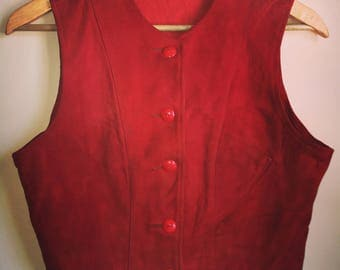 1930s nubuck leather buckle back vest with celluloid buttons and slant pocket.