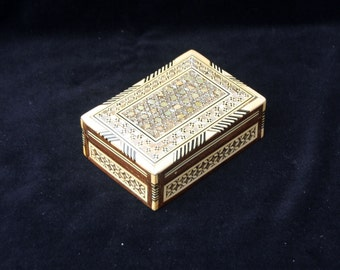Very attractive small wooden marquetry inlaid decorative box with mother of pearl. (3.25 x 4.65 x 1.25 inches)