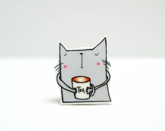 The cat that drinks tea pin badge