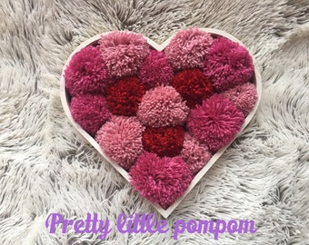 Large pom pom filled heart