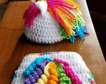 Unicorn hat and diaper cover set.