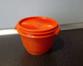 Tupperware solar cover canister , orange