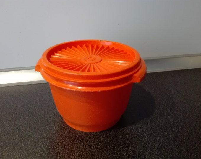 Tupperware solar cover canister , orange
