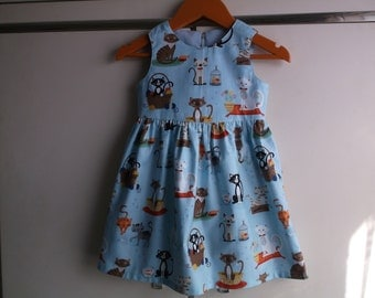 Cats on blue dress