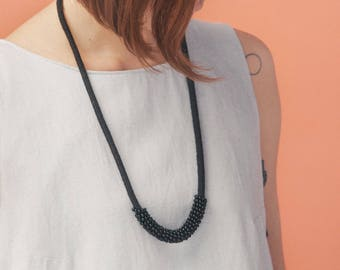 Model Charlotte black. Long necklace black rope and black beads. Magnetic clasp. Simple and minimalist design.