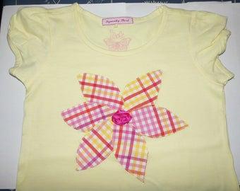 Yellow flower shirt.