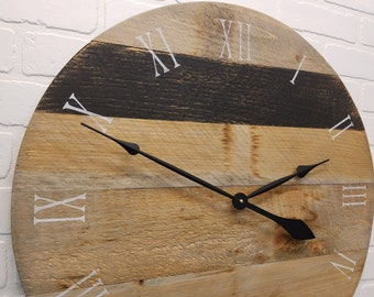 """24"""" rustic wall clock. Lightly grayed wooden wall clock with black stripe."""
