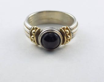 Gorgeous Sterling Silver and 14kt Gold ring with darkened CZ stone
