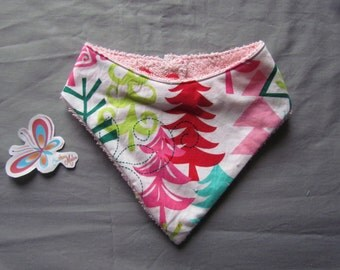 bandana bib with different trees with red or pink terrycloth