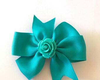 Teal pinwheel hair bow with center teal rose center