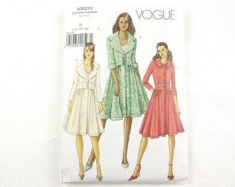 Vogue sewing pattern #V8211 for women's mid-knee flared coat in three styles sizes 12-16