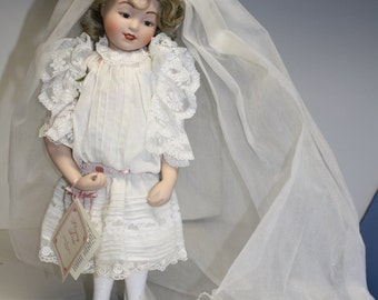 Playing Bride Doll by Maud Humphrey Bogert Bride Doll Porcelain Hamilton Collection Doll 1988 has tag