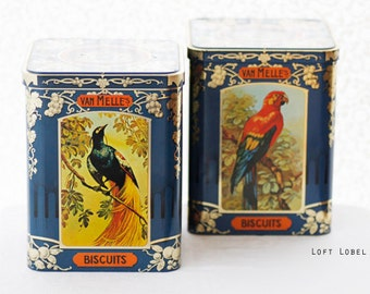 A pair of VTG darkblue square-shaped storage-tins ft. exotic birds surrounded by goldcolor decorations, van Melle Confectionary, Holland