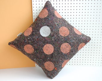Screenprinted cushion cover in grey recycled fabric, printed by hand with coral and silver polka dot design