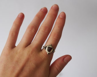 Handmade silver ring with garnet stone.