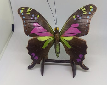 A coconut shelve butterfly with stand for decoration