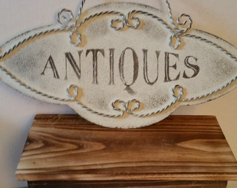 "Tin ""antiques"" sign"