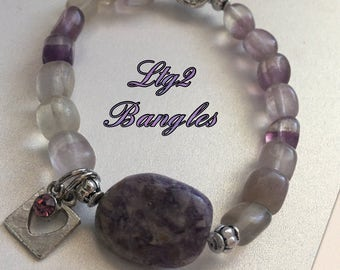 Lavender beaded stretchy bracelet.