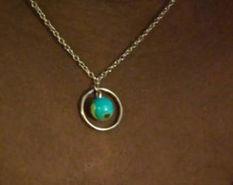 A World in the Ring Necklace