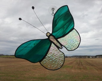 Stined Glass Butterfly Suncatcher in Irridescent clear glass and wispy Teal.
