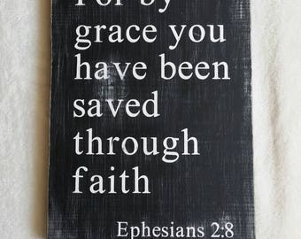 For by grace you have been saved through faith; Ephesians 2:8; Black and White Wooden Sign