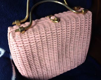Very large vintage pink woven wicker Dayne Taylor handbag made in Hong Kong with brass handles and clasp