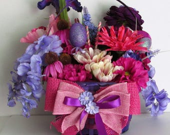 Purple Themed Easter Basket Floral Arrangement Centerpiece, featuring Easter Eggs, Candy-Striped Picks, and a Handmade Bow