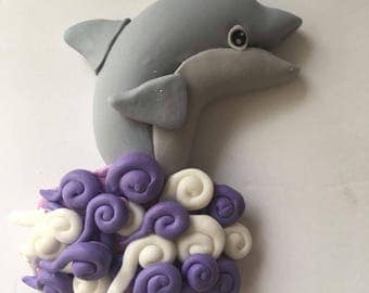Dolphin cake topper made out of fondant